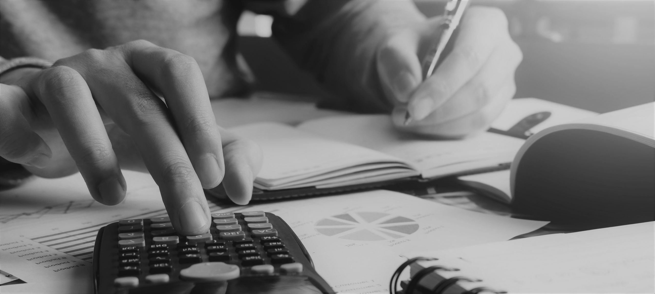 Close up hand man doing finance and calculate on desk about cost at home office